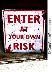"Buissness sign ""enter at your own risk"" on shop display..."