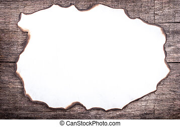 burnt paper on wood, can be used as a background or a frame for text