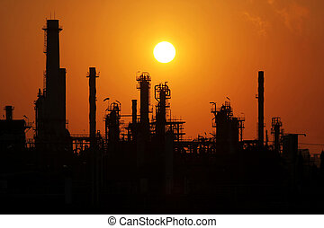 Oil refinery at sunrise - The silhouette of oil refinery at...