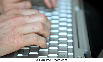 Man typing on laptop computer