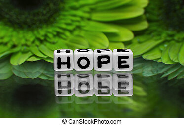 Hope text with green flowers in the background.