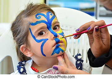 Child face painting - Little girl getting her face painted...