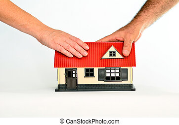 Real Estate Concept - Couple touch a toy house isolated on...