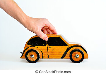 Car Business Concept - Woman hands holds toy car isolated on...