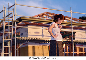 Buying a new house - Concept - Young pregnant woman worried...