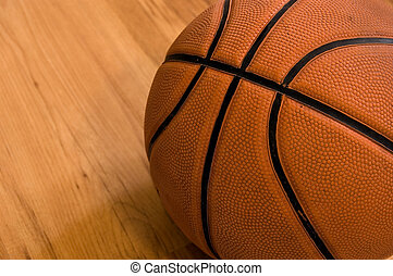 Basketball over wooden floor Close up