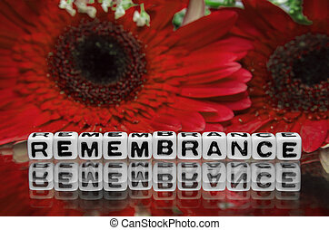 Remembrance text message the red flowers in the background.
