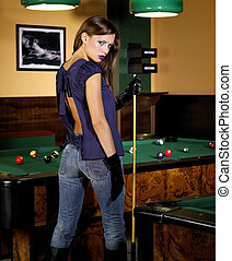 At pool - Young beautiful woman in a nightclub playing pool