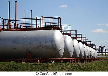 Gas storage tanks in a row - A photo of gas storage tanks