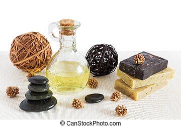 Spa with natural bath salt, candles, soap, towels and petals