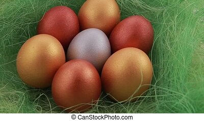 Golden Easter eggs on grass