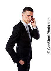 Handsome businessman talking on his mobile phone over white...