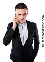 Business man talking on his mobile phone over white...