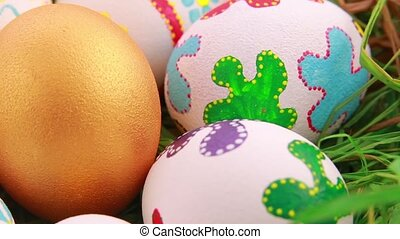 Colorful Easter eggs on grass Close up