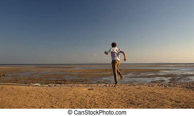 Happy man running away - Happy young man running far away on...