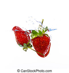 fresh strawberry dropped into water with splash on white backgrounds