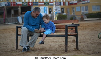 Grandfather and grandson on the bench