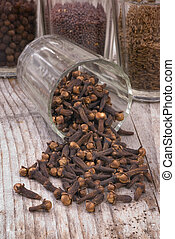 Cloves Eugenia caryophyllata - spice cloves on wood...