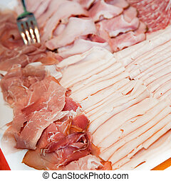 Assorted cold meats on a buffet platter