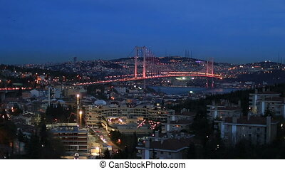 Bosporus Bridge at blue hours - time lapse city light with...