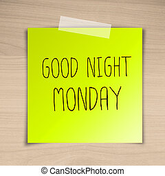 Good night monday sticky paper on brown wood background...