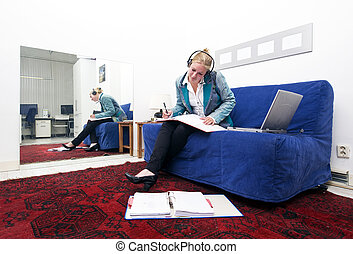 Home office - Businesswoman going over thick dossiers on a...