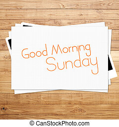 Good Morning Sunday on paper and Brown wood plank background