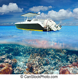 Beach and motor boat with coral reef underwater view -...