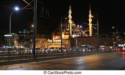 Galata Bridge with Mosque, - time lapse traffic on the...