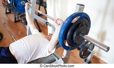 Exercising with weight lifting - Mature man working out...