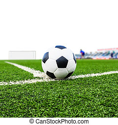 soccer ball on green grass field isolated on white...