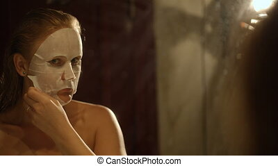 Result of applying a facial mask - Young woman removing a...