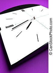 Clock - Wide angle shot of a clock on violet background