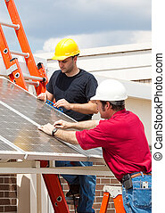 Green Jobs - Solar Energy - Electricians working to install...