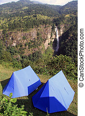 Blue tents - Blue tourist tents and waterfall near Manaslu,...