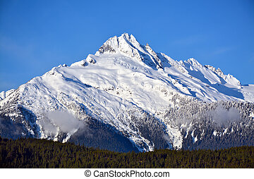 Tantalus Mountain in British Columbia - Snow covered...