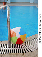 steps in a water pool and a children's ball - a steps in a...