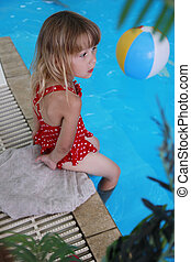 little girl playing in the pool