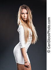 blonde model with lovely long hair and a curvaceous body...