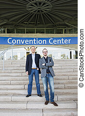 Convention Center attendees - Two attendees of a congress at...