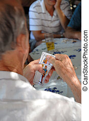 Man gamble - Men playing uruguayan card game called...