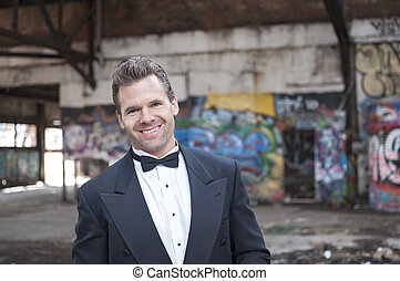 Formal wear in ghetto - Smiling handsome Caucasian man...