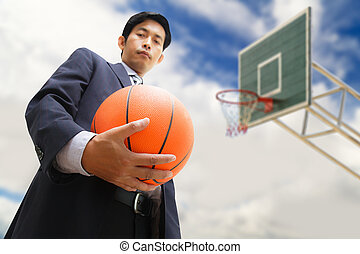 Business man with basketball
