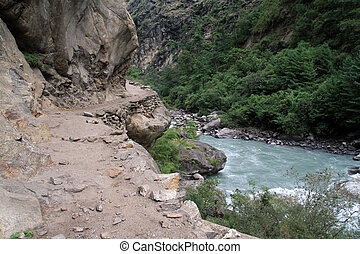 Dirt road and mount near river in Nepal