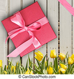 Red gift box with yellow tulips, In top view