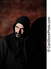 mistery man - a hooded man looking back