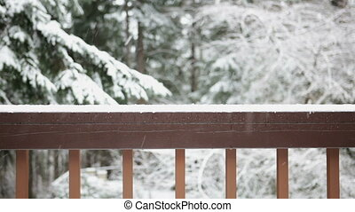 Snow from balcony - Snow scene from a balcony railing,...