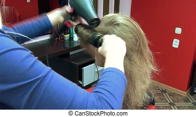 barber salon dry hair - closeup hairdresser barber blow dry...
