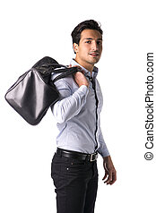 Young man with big leather bag over shoulder - Young man on...