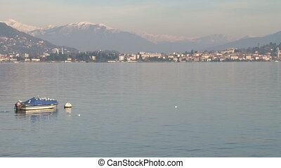 View of Lake Maggiore, Italy, with snowy mountains behind